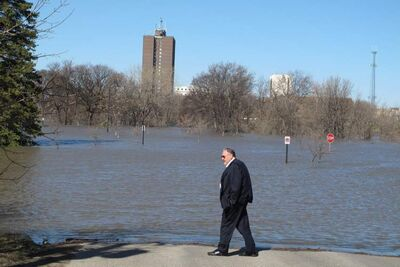 Fargo, N.D. Mayor Dennis Walaker looks at flooding from the Moorhead, Minn., side of the Red River on Tuesday. The river is expected to crest Wednesday at about 18 feet above flood stage.