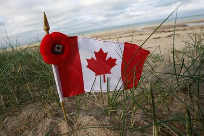 A Canadian flag is seen near Juno Beach, near Caen, Normandy.