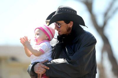 Matthew Dailey is relieved as he holds his daughter Olivia, 18 months, while waiting for his son Nathaniel to return from hospital in Portage la Prairie. Nathanial was found safe Saturday a few kilometres from his home in Sidney after disappearing Friday night.