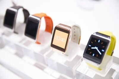 New Samsung Galaxy Gear in different colors are on display after the presentation in Berlin, Germany, Wednesday. Samsung has unveiled a highly anticipated digital wristwatch well ahead of a similar product expected from rival Apple. The so-called smartwatch is what some technology analysts believe could become this year's must-have holiday gift.