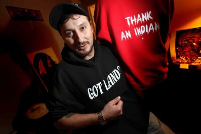 T-shirt and hoodie maker Jeff Menard poses with his hoodie featuring the 'Got Land? Thank an Indian' slogan. A  Saskatchewan student was told not to wear this sweatshirt in school, although officials have since relented.
