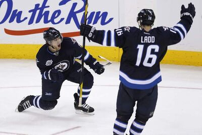 Winnipeg Jets' Jim Slater (left) celebrates his goal against the Tampa Bay Lightning with Andrew Ladd on Saturday, April 7, 2012.
