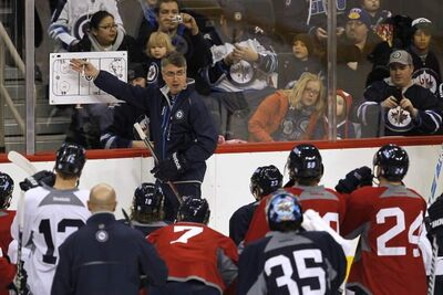 Winnipeg Jets head coach Claude Noel goes over some last-minute strategy at Friday's final training camp session.