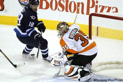 Winnipeg Jets' forward Bryan Little's shot is saved by Philadelphia Flyers' goalie Sergei Bobrovsky Saturday at the MTS Centre.