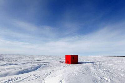 This ice fishing hut is located in Balsam Bay on Lake Winnipeg. It's a nice day for ice fishing.