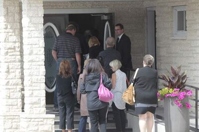 People arrive for the Memorial service in the MacKenzie Funeral Home in Stonewall Manitoba.