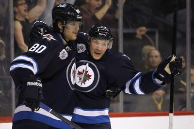 Winnipeg Jets' Nik Antropov (80) and Antti Miettinen (20) celebrate Antropov's goal against the Washington Capitals during second-period NHL action in Winnipeg on Friday.