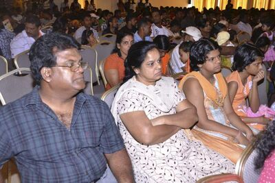 The Johendran family at a recent meeting with officials in Malaysia. They fled Sri Lanka two years ago and are stuck in limbo.