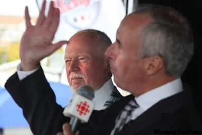 Ron MacLean (right) and Don Cherry of CBC's 'Hockey Night in Canada' ham it up during a broadcast.