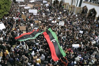 In this photo released by China's Xinhua News Agency, Libyan protesters demonstrate against Libyan leader Moammar Gadhafi during a rally at the Court Square in Derna, northeastern Libya, in 2011.
