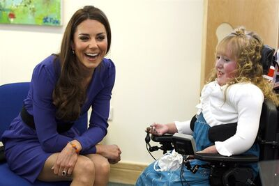 Britain's Duchess of Cambridge meets Bethany Woods in a music class during a visit to The Treehouse in Ipswich, England, Monday, March 19, 2012. The Duchess of Cambridge visited to formally open The Treehouse, a children's hospice service for Suffolk and Essex. (AP Photo/Kirsty Wigglesworth, pool)