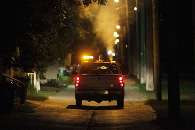 A City of Winnipeg crew fogs for mosquitoes in a River Heights back lane Sunday evening. City entomologist Taz Stuart has said the fogging campaign will be short and targeted to areas with the largest mosquito-trap counts.
