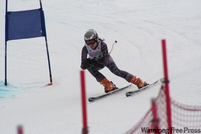 Alexandrea Murray, a Grade 9 student on the provincial team, trained in the rain on the weekend at Asessippi.