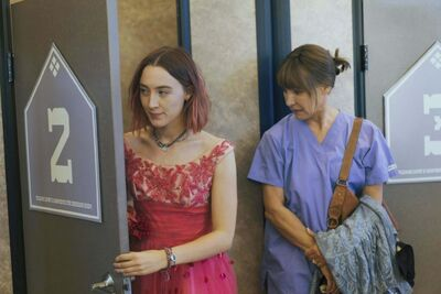 Saoirse Ronan (left) and Laurie Metcalf in the film Lady Bird. (Merie Wallace / A24)