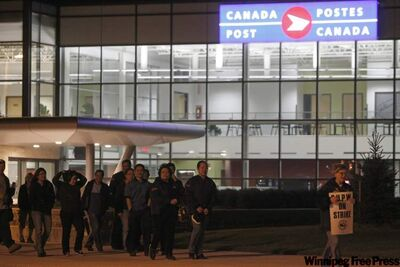 About 150 workers from the new mail-processing facility near the airport in Winnipeg hit the bricks Thursday night.