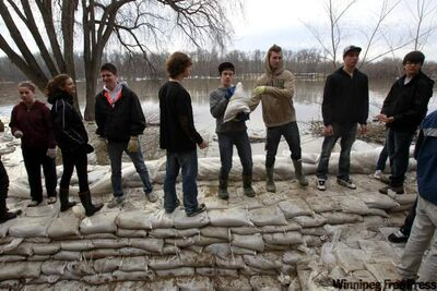 Dakota Collegiate students and staff help sandbag a residence on Cloutier Drive last week.