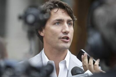 Liberal Leader Justin Trudeau answers questions from the media in Quebec City on Thursday about his use of marijuana.