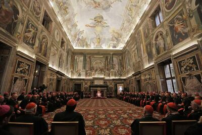 Pope Benedict XVI (centre at far end of hall) delivers his message on the occasion of the exchange of Christmas greetings with the Roman curia Friday in the Clementine Hall of the Vatican.