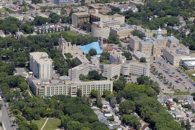 The Université de Saint-Boniface and Saint Boniface Cathedral are seen in an archived aerial photo.