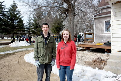 Students from Glenlawn Collegiate were out of the classroom last week to help build a sandbag dike around this south-of-the-perimeter property, including Brendan Murphy and Mikayla Zacharias.