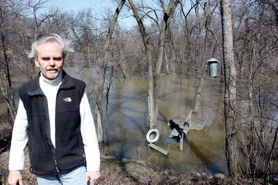 Will Barmeier's property is experiencing spring flooding from the Seine — his small dock partly submerged — thanks to the rising water levels of the Red River.