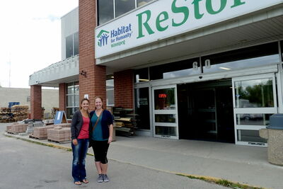 Rayna Rieger and Kera Barber stand outside the Habitat for Humanity office at 60 Archibald St. The two University of Winnipeg students are among a group of college and university students in Winnipeg helping Habitat for Humanity build decks for homes built by Habitat at Fernbank and Main.
