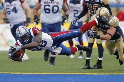 Winnipeg Blue Bombers' Brady Browne (25) can't stop Montreal Alouettes' Jamel Richardson (18) as he dives in for the touchdown during the first half of their CFL game in Winnipeg on Friday.
