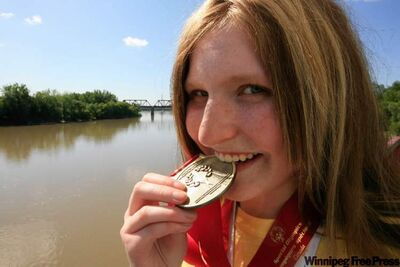 Winnipeg's Ashley Wilwand tests the gold in the medal she won in rhythmic gymnastics rope competition at the National Special Olympic Games in London, Ont., last week. She also took home three silvers and a bronze in other disciplines.