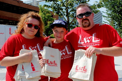 Aug. 28 -- Nathan Unrau and his parents gave away lunches and customized reusable lunch bags at Lunches with Love on Aug. 23. Coca-Cola was present giving away free drinks.