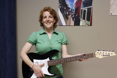 July 24 -- Jessica Dressler of the West End Cultural Centre rocks out with an electric guitar. (CINDY CHAN) METRO