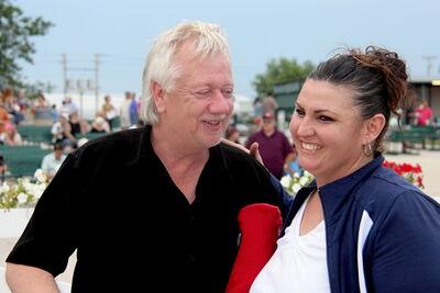 Horse owner Bob Stremich hugged everyone in sight, including his trainer, Shelley Brown, after his filly won.