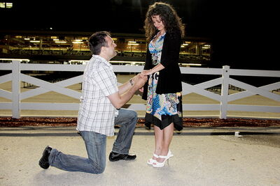 Joe Rodrigues proposes to Gorete Tavares in the winner's circle.