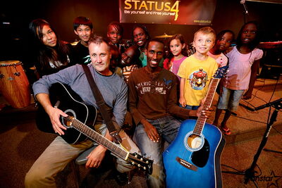 """Const. Kevin Gibson and Gentil Misigaro with some of the kids from Status 4 at 575 Larsen, a group Coun. Steen is """"proud to support."""