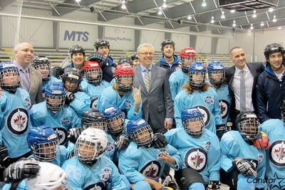 Premier Selinger with Point Douglas MLA and minister of children and youth opportunities Kevin Chief, Dwayne Green, Executive Director of the Winnipeg Jets True North Foundation and participants from the Foundation's hockey program. Selinger announced a new After School Leaders program, meant to provide mentorships and internships to youth in high needs communities, at the end of November.