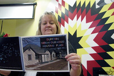 Dufferin Residents Association past chair Sandie Komarniski peruses the Dufferin Neighbourhood Housing Plan, a plan recently tabled at city council. The plan sets a series of goals for the neighbourhood and ways to achieve them.