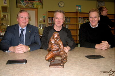 From l-r: Carte International CEO and project donor Brian Klaponski, sculptor Charlie Johnston, and Andrew Mynarski VC School principal Doug Taylor pose with a scale model of a statue of North End war hero Andrew Mynarski. Johnston revealed the model to the Mynarski statue project committee Jan. 22.