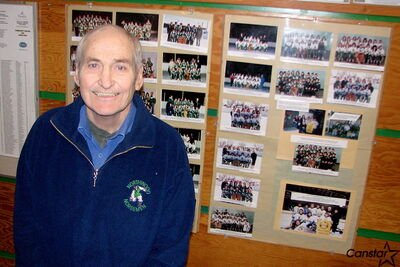 Northwood Community Centre president George Vanderlip, with photos chronicling years of successful ringette teams the centre has produced. The community centre marks its 60th anniversary this year and its board is currently discussing how it intends to celebrate.