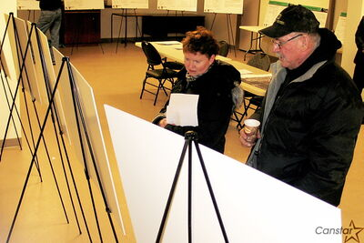 Photo by Darren Ridgley Residents study placards laying out key points of a  proposed residential area at the intersection of King Edward Street and Jefferson Avenue.