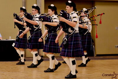 Pipe band members play during practice at the Prairie Community Youth School of Pipes and Drums.