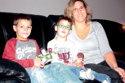 Meighan Andrews (right) sits with sons Jesse and Logan. Logan, 4, was named this year's ambassador child for the Children's Wish Foundation after he courageously battled through a pair of heart surgeries.