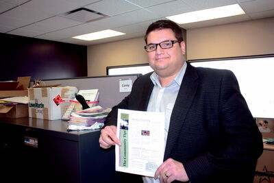 River East Transcona School Division inclusion specialist Corey Kapilik holds the inaugural issue of The Community Tipi.