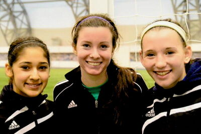 Jasmine Lotey (from left), Brooke Richtik and Megan Diamond had an English soccer adventure last month.