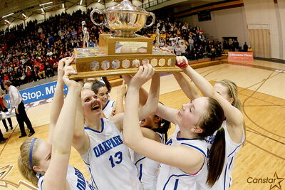 The Oak Park Raiders celebrate their provincial basketball championship after completing a perfect season.