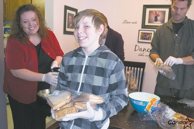 Nathan Unrau, 12, began Lunches With Love as a school project. Now it's something that he and dedicated volunteers do every second week.