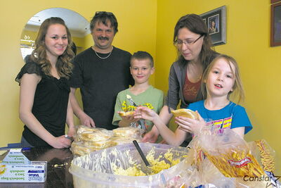 From left to right: Kayla DeRyk, Ken Wowk, Robby Wowk, Shirley Wowk and Amanda Wowk. The St. James family recently launched its Food For Hope project, prepping sandwiches for the Main Street Project.