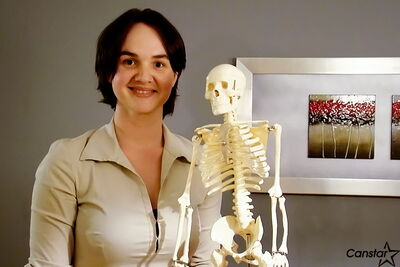 Dina Birenboim, registered massage therapist with 'Buddy, a skeletal model she uses in her practice.