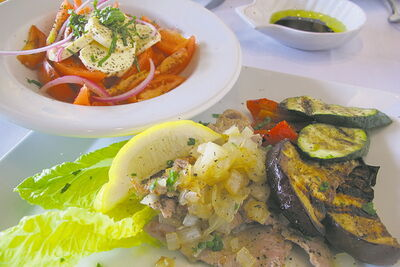 Veal escalopes with grilled eggplant, zucchini and red pepper, accompanied by tomato and bocconcini salad.