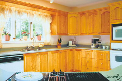 A little bit of mild dish soap and some water is an effective combination when it comes to cleaning wood cupboards.