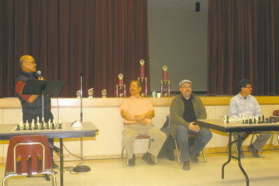 Ted Marcelino (centre) and his assistant Rey Sangalang (left) at the Tyndall Park Open Invitational Chess Tournament in 2012. Chess is growing in Tyndall Park, Marcelino writes.