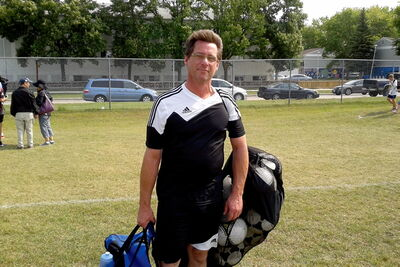 Coach Mike Reilly walking off the field after his WSEU U-14 PD team was forced to a 1-1 draw.
